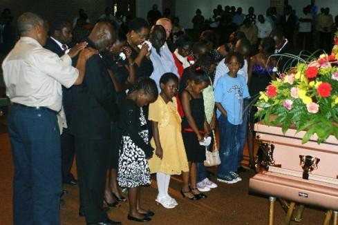 Family members for line up for prayers led by Pastor John Mugo. Photo by Tony Karanja-(Jambonewspot)