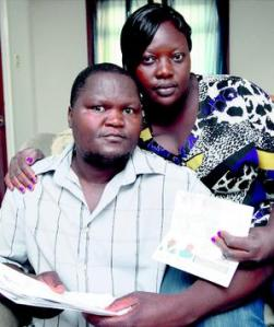 Joseph and Christabel Lumbasi displaying the visa applications.