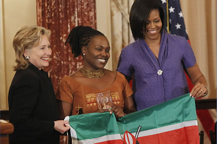 Kenya's Ann Njogu receives the International Women of Courage Award at the State Department in Washington award as she is flanked by US First Lady Michelle Obama and US Secretary of State Hillary Clinton