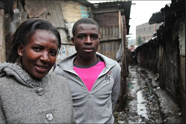 Jane Ngoiri with her son, Anthony, in Nairobi's Mathare slums, where she lived before moving to a safe suburb. The scar on her forehead is the result of being smashed with a rock by a gang member in Mathare, where crime is rampant. She nearly died from the attack. Credit: Nicholas D. Kristof/The New York Times