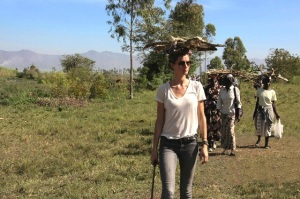 Gisele carries firewood on her head alongside Kenyan women