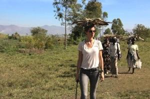 Gisele carries firewood on her head alongside Kenyan women
