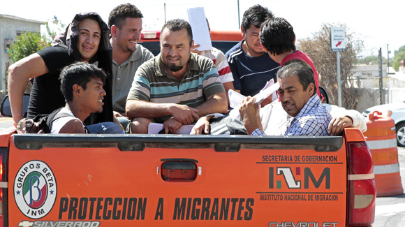 A group of deported men ride in the back of a Grupos Beta pickup through Mexicali, Mexico. Grupos Beta is a government migrant protection organization. (Don Bartletti, Los Angeles Times / September 20, 2011)
