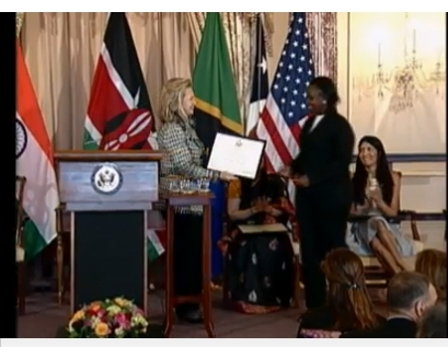 US Secretary of State presents an award to Annette Otieno of KickStart a non-profit helping poor women in Tanzania through a farming irrigation tool