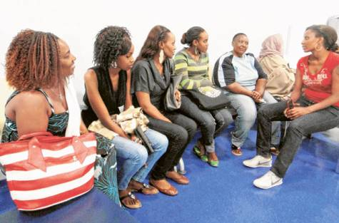 Hannah Mwikamba (second from right), mother of Esther Wanjiru Mwikamba, interacts with members of the Kenyan community in Dubai. When she is not by Esther's side, she reportedly sits in the lobby and weeps silently.