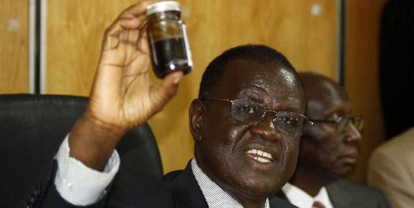 Photo/STEPHEN MUDIARI Minister for Energy Kiraitu Murungi lifts a bottle containing crude oil during a press conference at Nyayo House in Nairobi, March 26th, 2012. The minister announced that oil has been discovered in Turkana county.