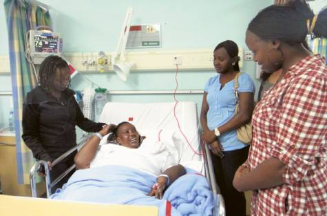 Lucy Mwikamba (left) with her mother Hannah and visitors at Rashid Hospital. The mother of attack victim Esther is under treatment after suffering a mild stroke.