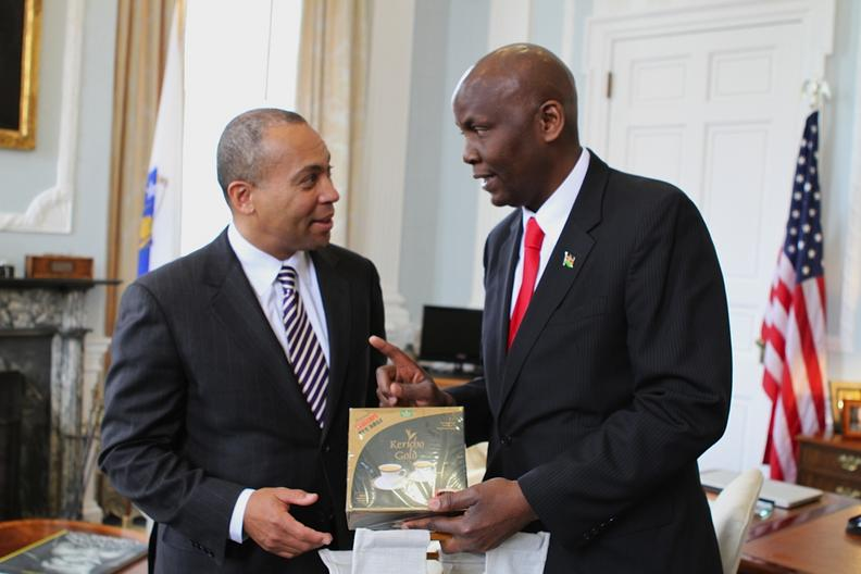 Ambassador Odembo presents the Governor with the finest Kenyan tea bags