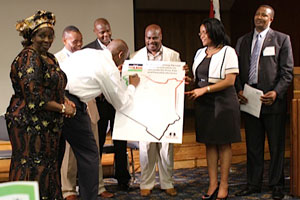 Ambassador Elkanah Odembo leads Kenyans in signing a peace pledge in Boston. [Chris Wamalwa/Standard]