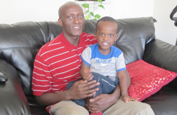 Richard Nyaribo, and his three-year-old son, Joshua. Nyaribo endured a nightmarish scenario when his Kenyan mother, Jerusa Nyaribo, was diagnosed with colon cancer while uninsured when visiting in Nov. 2010.