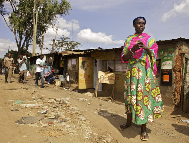 Limited lifeline: Zuhura Hussein, who does outreach in Nairobi's Kibera slum, has the names of many TB sufferers and HIV-positive clients on her phone but no technology to track them. Credit: Frederic Courbet/Getty Images